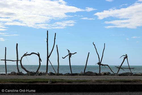 Hokitika Driftwood Sign on Hokitika Beach, West Coast, South Island, New Zealand