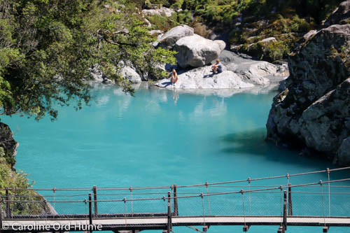 Turquoise Water of Hokitika River and the Swing Bridge Over the Gorge, West Coast, New Zealand