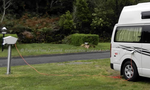 Powered Site - Campervan Plugged into Power on a Campervan Site in New Zealand