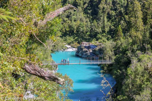 Aerial view of Hokitika Gorge turquoise water and swing bridge, West Coast, New Zealand